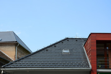 New Shingles Roof with Skylights Windows and Rain Gutter. New brick house with lightning conductor