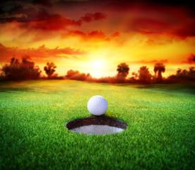 Photo sur Aluminium Golf Ball In Hole - Golfing - Target Concept