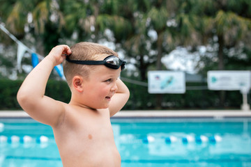 Boy wearing swimming goggles