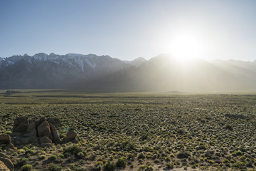 Scenic view of landscape against mountains during sunny day