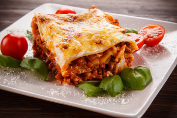 Lasagna on wooden background