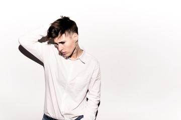 Model in white shirt posing on isolate background