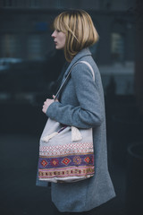 Young fashionable woman walking on the street