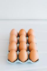 Brown chicken eggs displayed on an enamel countertop