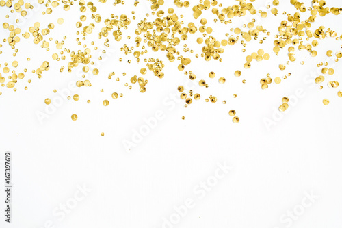 Golden confetti tinsel on white background  Flat lay, top