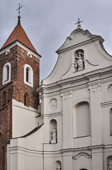Baroque facade of the church with a Gothic bell tower in Gniezno.