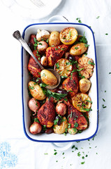 Oven-roasted spicy Chicken with Potatoes, Olives, Garlic, Onions and Lemon