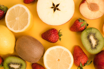 Set of fruits in a cut on a yellow background