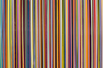 Vertical stripes of various colors thin width with texture.