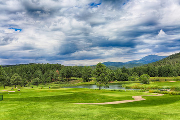 Mountain resort, golf courses. HDR image.