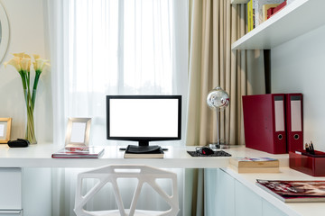 Computer display and office tools on desk in home. Desktop computer screen isolated. Modern creative workspace background. Workspace at home.