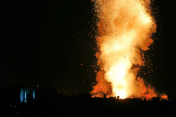 Pyrotechnicians launch fireworks from the safety of their shelter during week-long celebrations marking the feast of the Assumption of Our Lady in Mosta