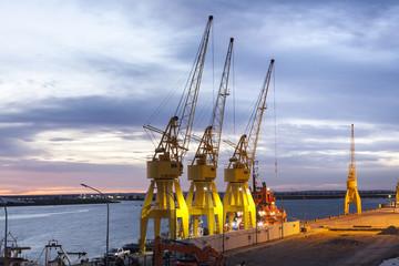 Old yellow port cranes in Huelva, Spain