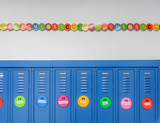 School lockers decorated with smiley faces and welcome back banner