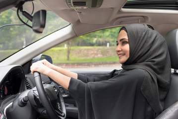 Arab women driving car.