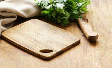 Food background, wooden cutting board and knife