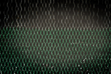 picture of green grass with old wood fence blended with metal screen for abstract background, filtered tones