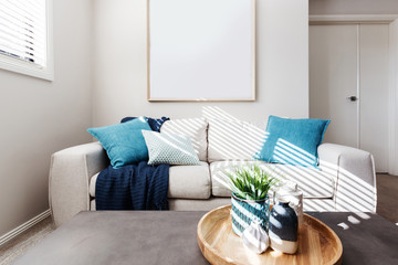 Living room sofa with blank picture mock up for your artwork