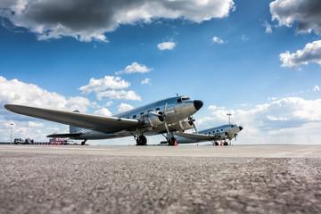 Retro passenger planes at the airport apron