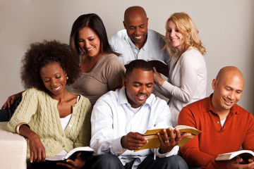 Diverse group of friends reading.