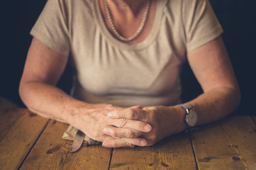 Senior woman waiting at table in cafe