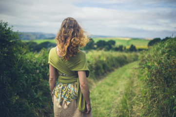 Young woman walking in countryside