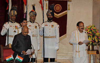 Indian President Ram Nath Kovind administers the oath of the new Vice President to Venkaiah Naidu during a swearing-in ceremony at the presidential palace in New Delhi