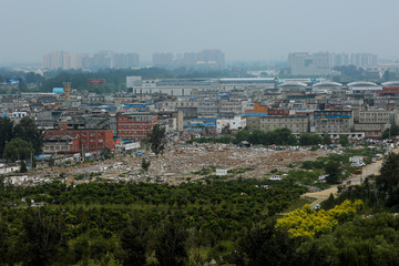 Debris covers the ground where former migrant dwellings used to stand at the outskirts of Beijing