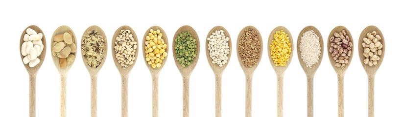 Variety of raw legumes and rices in spoons - white background