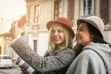 Two young girl. Female best friends taking self-picture with the phone