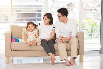 asian family on sofa