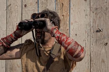 Steampunk man wearing glasses with binoculars