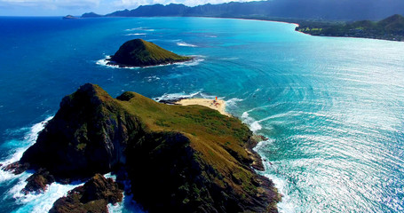 Two Remote Coastal Islands in the Pacific Ocean with a Small Beach Surrounded by Turquoise Blue Ocean Waters - Aerial Shot in Oahu, Hawaii