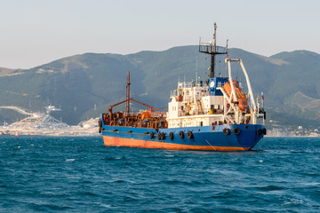 Cargo ship anchored in the roadstead Tsemes bay at the entrance of the port of Novorossiysk, Russia