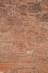 Wall mason out of red sandstone