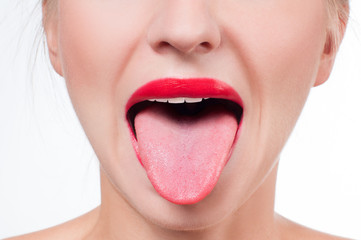 Female tongue and red painted lips