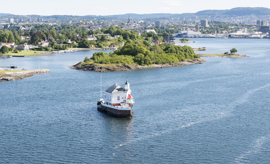 small island with building in Oslo harbor