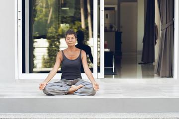 Senior Woman Meditating Outdoors