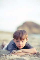 Boy Laying On Tummy At the Beach