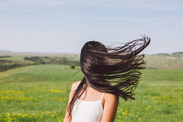 Woman portrait when the wind blow her hair covering her face