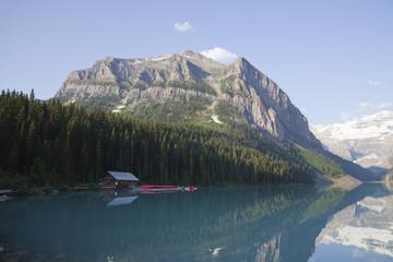 Canoe and kayak rental shack at the beautiful emerald colored water of Lake Louise in Banff national park, Alberta, Canada.