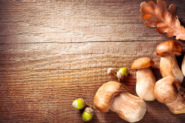 Ceps mushroom. Boletus border design on wooden rustic table