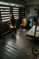 Woman posing in decayed home