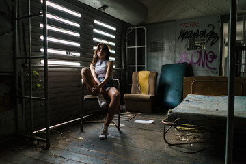 Woman sitting in decayed house