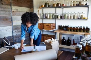 Millennial African American Woman businesswoman in her skincare studio