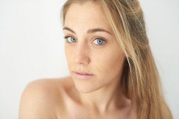 Close-up of sensual beautiful girl looking at camera