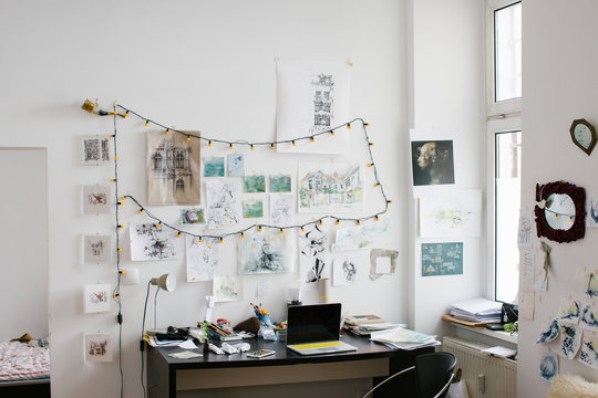 White Bright Artist Studio With Original Artworks on Wall