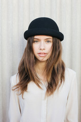 Portrait of a beautiful female teenager with hat