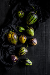 Pear-melons on a black wood table