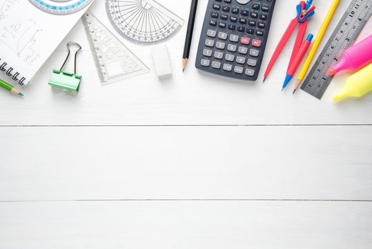Office tools and School supplies, stationery, on wooden table, top view.